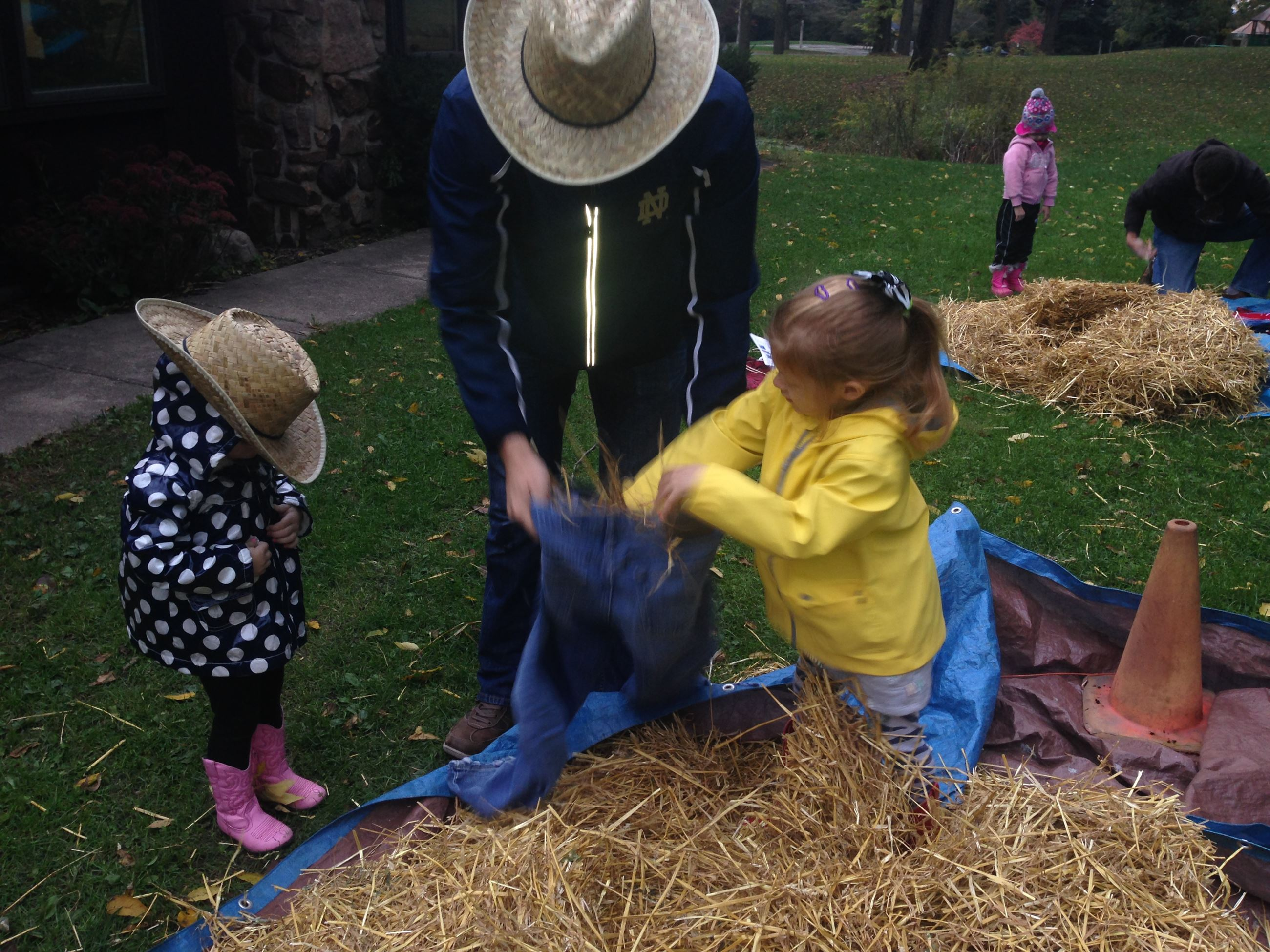 family builds a scarecrow
